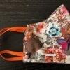 Mascarilla de flores y mariposas